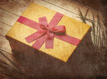 Plam branch and holiday gift box stock images
