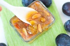 Plam jam with almonds. Stock Photos