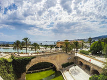 Plama de Mallorca beach. View on the beach of Plama de Mallorca with palm trees, medieval architecture and yachts, Balearic islands, Spain Royalty Free Stock Image