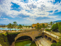 Plama de Mallorca beach. View on the beach of Plama de Mallorca with palm trees, medieval architecture and yachts, Balearic islands, Spain Stock Image