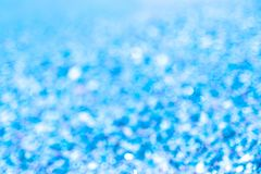 Plamy tła abstrakcjonistyczny błękitny okamgnienie zaświeca bokeh obraz stock