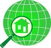 Planète avec la maison dans la loupe Photographie stock libre de droits
