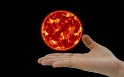 Planète de The Sun planant au-dessus de la main Photo stock