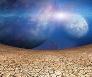 Planètes et terre criquée Image stock
