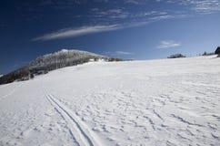 Planície nevado da montanha imagem de stock royalty free
