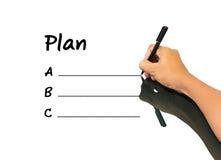 Plan ABC de la escritura del hombre de negocios Fotografía de archivo libre de regalías