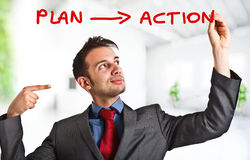 Plan and action. Friendly businessman writing his business strategy on the screen Royalty Free Stock Photo