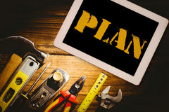 Plan against desk with tools Royalty Free Stock Photos