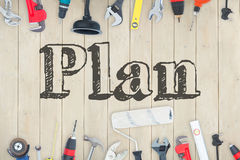 Plan against diy tools on wooden background Royalty Free Stock Photo