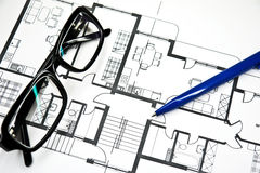 Plan of apartment with  pencil and glasses Stock Images