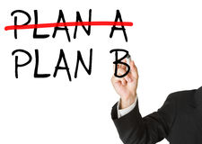 Plan B as alternative for plan a - man writing on whiteboard. Man writing plan b on whiteboard after crossing out plan a - decision or alternative concept Royalty Free Stock Photo
