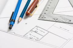 Plan with bevel. Closeup of a pencil on a house plan stock photo
