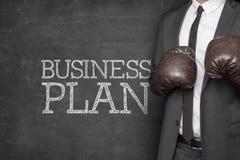Plan biznesowy na Blackboard z biznesmenem fotografia stock