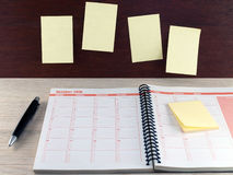 diary planner, pen, and Sticky notes on wood Royalty Free Stock Photo