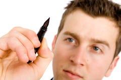 Plan d'action - homme avec le crayon lecteur Image stock
