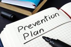 Plan de la prevención escrito en un cuaderno de notas foto de archivo libre de regalías