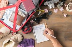 Plan de voyage d'hiver d'écriture de main de voyageur Photo libre de droits