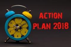 Plan Działania 2018 pisać z budzikiem na czerń papieru backgro Zdjęcia Stock