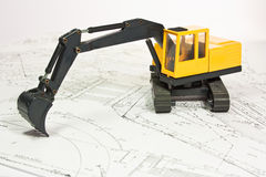 Plan and excavator Stock Image