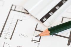 plan för arkitekt 3d framför rullar Arkivfoto