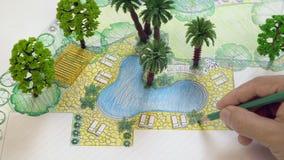 Plan för landskapsarkitektdesignträdgård lager videofilmer