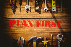 Plan first against desk with tools Royalty Free Stock Photo