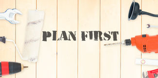 Plan first against diy tools on wooden background Stock Photography