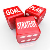 Plan Goal Strategy Words on Three Red Dice. The words Plan, Goal and Strategy on three red dice, symbolizing taking a gamble on improving your fortunes with Royalty Free Stock Photography