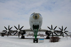The plane is going to the sky. There is one wing of TU 114 plane.Front view with all 4 engines. The photo was take in winter. This is largest and fastest Royalty Free Stock Images