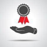 Plan hand som ger emblemet med den röda bandsymbolen stock illustrationer