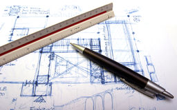 Plan of a house with a pen Royalty Free Stock Photos