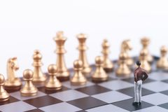 Plan leading strategy of successful business leader concept. Miniature people small figure businessman standing alone on chess board game. With copy space royalty free stock images