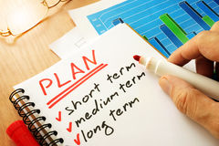Plan with list short, medium and long term. Business concept Stock Images