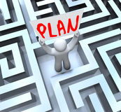Plan Man Holding Sign in Maze Labyrinth. A man holds a sign with the word Plan in a maze or labyrinth to symbolize a way out royalty free illustration