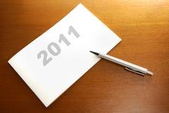 Plan mit 2011 Zeitplänen Stockbild