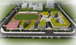 Plan of a modern school. Illustrated 3d aerial view of a modern school with a sports field and athletic track Royalty Free Stock Photography