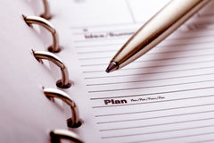 Plan organizer. The word plan and pen closeup in organizer Royalty Free Stock Photos
