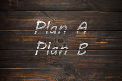 Plan A or Plan B, written on a wooden old board. Royalty Free Stock Photos