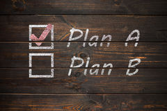 Plan A or Plan B, written on a wooden old board. Royalty Free Stock Photo