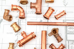 An Plan plumber. Plumbing Tools Arranged On House Plans Royalty Free Stock Photos