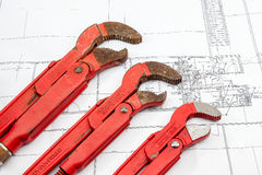 Plan plumber. Plumbing Tools Arranged On House Plans whit wrench Stock Images