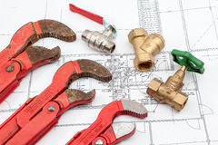 Plan plumber. Plumbing Tools Arranged On House Plans whit wrench and water valves Stock Images
