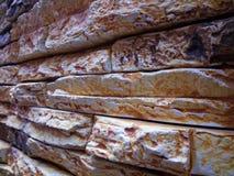 Plan rapproché avec le mur en pierre naturel Photographie stock