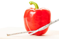 Plan rapproché avec le poivron rouge et le centimètre Photos stock