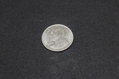 Plan rapproché 1 baht - pièces de monnaie thaïlandaises d'isolement sur le fond blanc image libre de droits