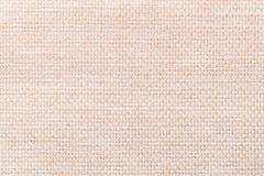 Plan rapproché beige léger de fond de textile Structure du macro de tissu Photos libres de droits