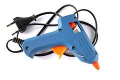 Plan rapproché bleu d'arme à feu de colle sur le fond blanc image stock