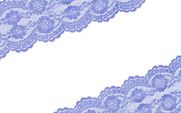 Plan rapproché bleu de dentelle sur le blanc Images stock