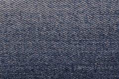 Plan rapproché bleu-foncé de fond de denim Tissu texturisé Photographie stock libre de droits