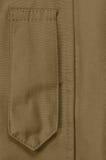 Plan rapproché bronzage de boucle d'insigne d'insignes de grade de parka du coyote ECWCS, l'espace vertical vide vide de copie de photos stock